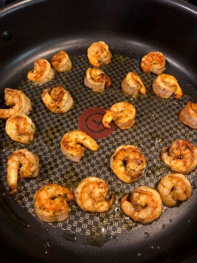 Spicy shrimp cooking in pan