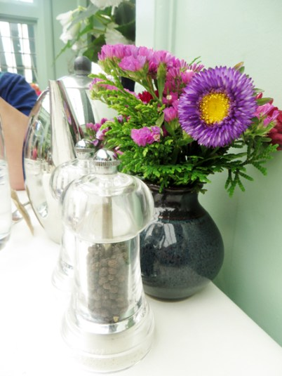 pretty flowers on every table at the Butchart's Afternoon Tea