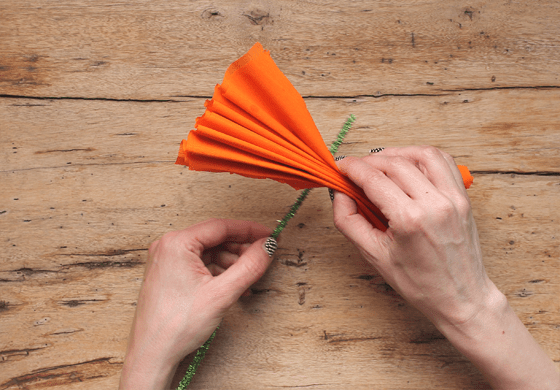 putting piping around crepe paper flower