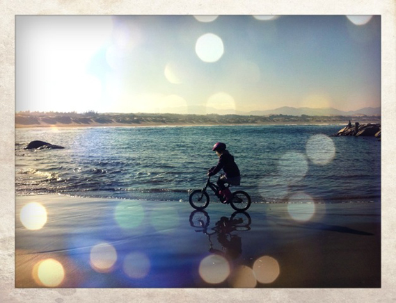 cycling helmeted girl live life ritoque beach chile