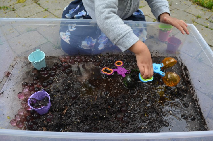 Water beads in mud for toddlers