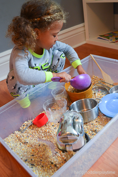 birdseed kitchen sensory bin for toddlers and preschoolers