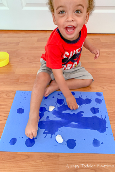 Painting with cotton balls and water for toddlers