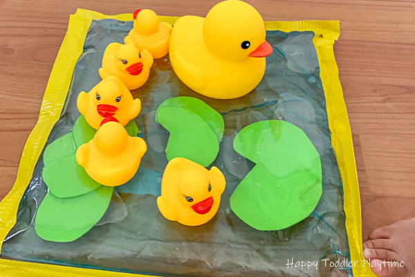 Pretend play sensory activity with rubber ducks for toddlers