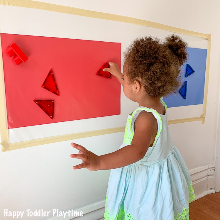 a fun contact paper sticky wall activity for toddlers and preschoolers