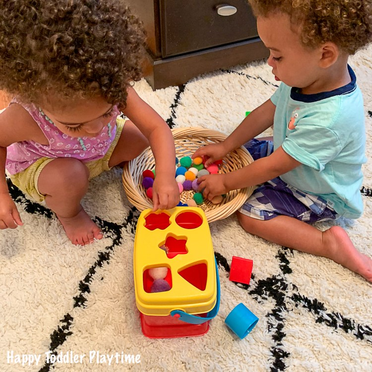 A Pom Pom shape sorting activity for toddlers
