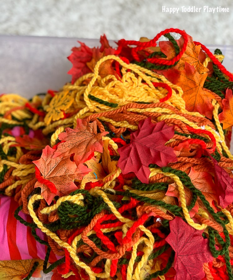 a yarn sensory bin for Fall for babies and toddlers a