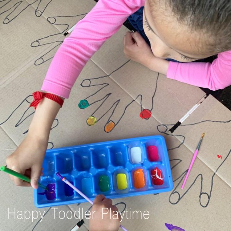 giant nail salon painting cardboard box activity