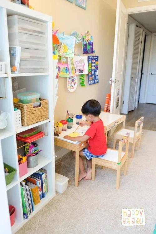 Preschooler making art in a preschool homeschool room
