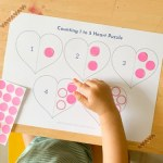 Toddler learn to count and sticking dot stickers