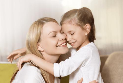 Mum and child hugging