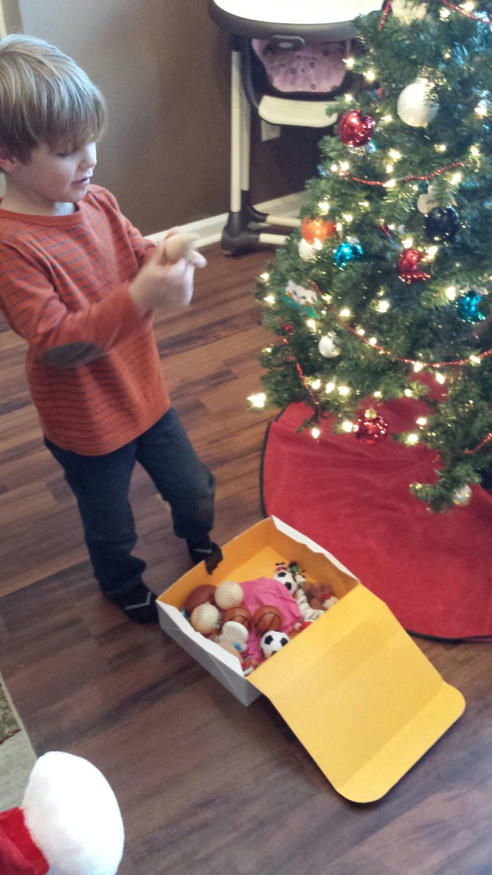 """He was putting his """"special"""" ornaments on the tree."""