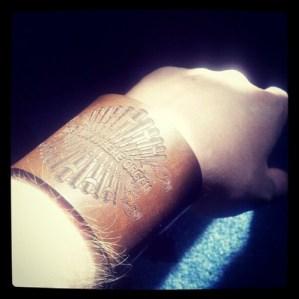 One of the Kickstarter backer rewards - a laser cut leather wrist cuff.