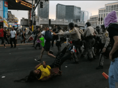 Image shows protesters clashing with police in America