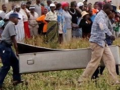 File photo. Police carrying a dead body