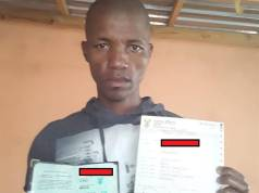 A frustrated Mbongeni Sithole shows his ID book and death certificate. .