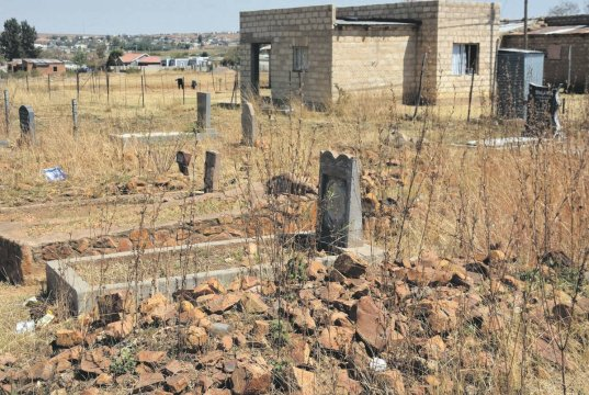 Residents of Manaleni Village in Mpumalanga say ghosts leave nearby graves and haunt them at night. Photo by Bongani Mthimunye.