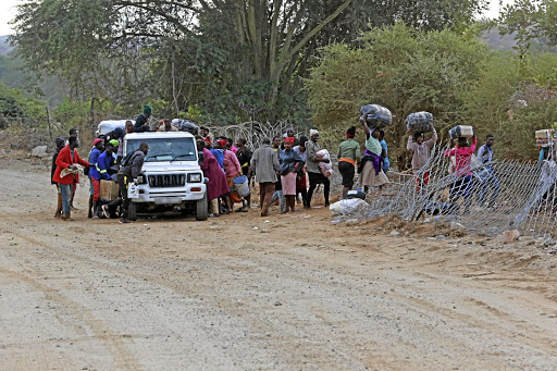 Image: Thapelo Morebudi Zimbabweans who crossed illegally into SA to shop for groceries load up and cross back into their country using one of many wide gaps in the expensive Beitbridge border fence.