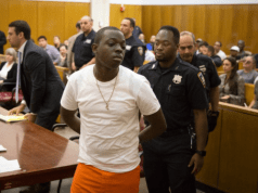 "Bobby Shmurda in court in Manhattan on Wednesday. Before he was arrested, he had risen quickly in the hip-hop world, riding the success of an independent single, ""Hot Boy.""Credit...Kevin Hagen for The New York Times"