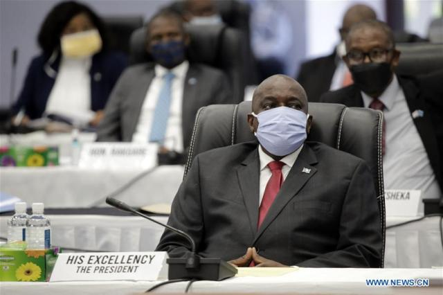 Botswanan President Mokgweetsi Masisi attends a parliament meeting in Gaborone, Botswana, May 5, 2020. Botswana has intentions to slowly open up the economy following a five weeks lockdown, ending on Thursday, to fight COVID-19 pandemic. The country's legislators will convene an emergency parliament meeting on Wednesday to discuss new regulations expected to usher in opening of businesses and schools, under strict supervision. According to proposed regulations, presented by President Mokgweetsi Masisi to parliament on Tuesday, the Southern Africa country wants to gradual allow businesses, traders or school to operate after satisfying Health Services Director or any authorized official that they will prevent the spread of COVID-19. (Photo by Tshekiso Tebalo/Xinhua)