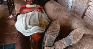 Nomvuzo Tshuku of Ocean View in Jeffreys Bay has left her room to sleep in the lounge with her shoes on because she is terrorised by rats that crave meat.Inset: Rats damaged her Tupperware. Photos by Mkhuseli Sizani.