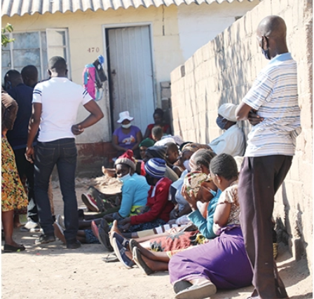Mourners at the Sianzembe home where a child died while three others are hospitalised after consuming poisoned porridge in Old Magwegwe suburb, Bulawayo