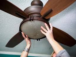 Holding the Ceiling Fan to the Ceiling