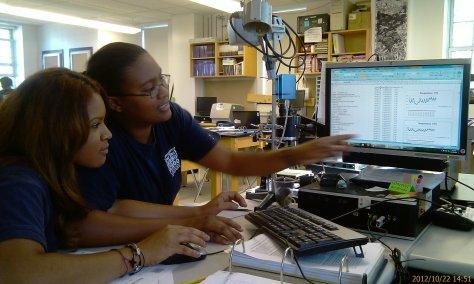 Stephanie and Jasmine work on their data.