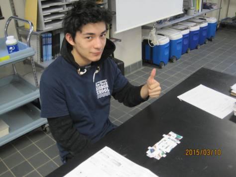 Marine Research Scholar Jose after building the Foldscope.