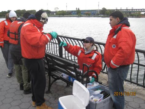 Cézanne Bies teacing her phys-chem team how to perform the Winkler Method to measure the dissolved oxygen of the Harlem River.