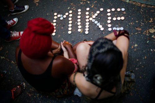 People attend a vigil to honor Michael Brown in Brooklyn
