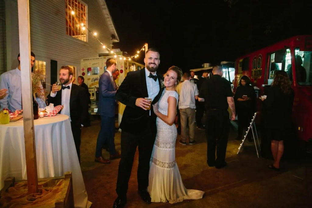 Happy wedding couple at food truck wedding