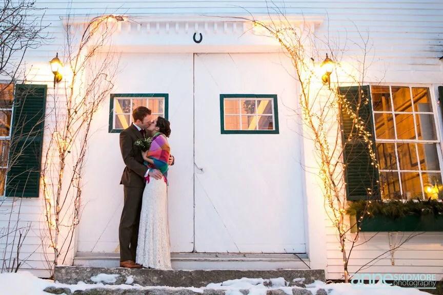 Winter wedding barn kiss