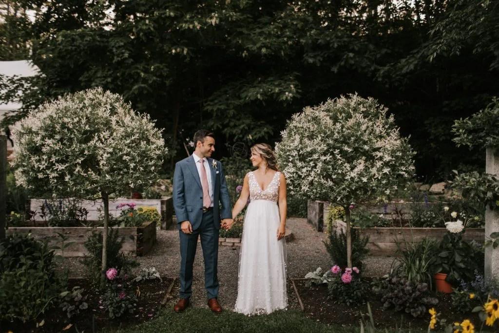 Beautiful couple in Maine wedding garden