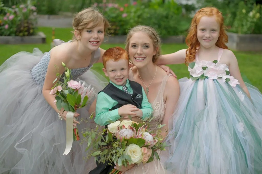 Maine bride with fairy flower girls