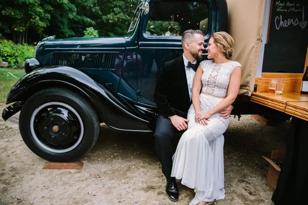 two piece wedding dress sitting with groom