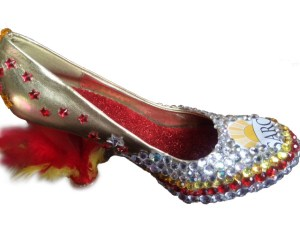"""One of the four """"bedazzled"""" shoe trophies created by SARC staff that will be presented after this year's Walk a Mile in Her Shoes challenge."""