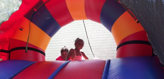Young attendees at a previous Summer Jam enjoy the free moon bounce and slide, a returning attraction at this year's event.