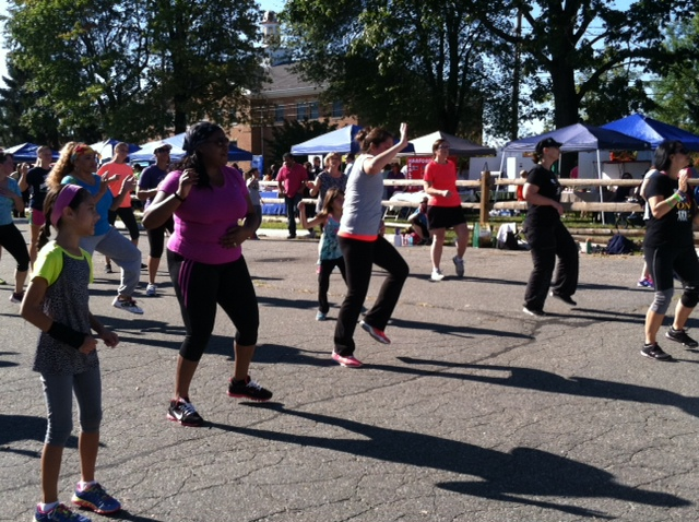 A crowd of attendees take part in a Zumba class at Healthy Harford Day 2014.
