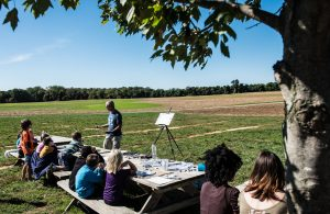 Watercolor artist Ken Karlic addresses a group of children during the children's plein air painting demonstration at Broom's Bloom Dairy. The event was part of the Harford County Plein Air Art Festival. Photo Credit: Bill Garvin, BG Photos