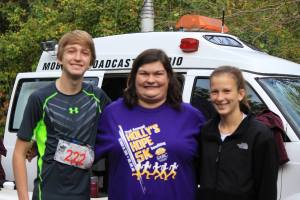Top finishers and siblings Russell and Lydia Davis flank Holly, the namesake of the Holly's Hope 5K.