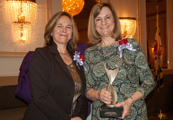 Stephanie Hau, president/CEO of Chesapeake Environmental Management and recipient of the 2015 ATHENA Award, presents this year's ATHENA Award to Carolyn Evans, partner at Sengstacke and Evans, LLC. (Photo by Lauren Ciambruschini/Harford Community College)