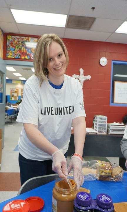 Laura Dahl, Office of Economic Development, making sandwiches for the boys and girls