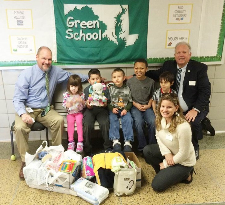 Students in Hickory Elementary School's Patriot Program donating baby supplies to Harford County's Project Healthy Delivery, which helps give newborns the best chance at a drug-free life. Pictured from left to right are Principal Brad Stinar; students Abby Landolt, Chris Medina, Miguel King, David Miles, and Bryson Diaz; Joe Ryan, manager of the Harford County Office of Drug Control Policy and (in front) Amber Shrodes, director of Harford County Community Services for County Executive Barry Glassman.