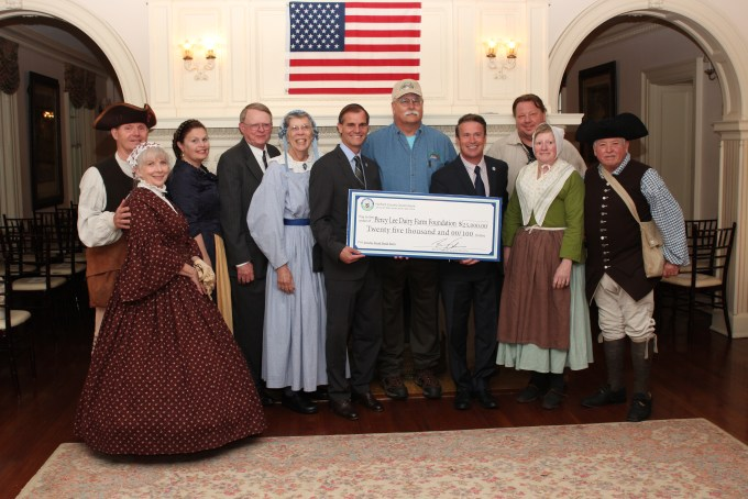 Harford County Executive Barry Glassman (center right) and Director of Administration Billy Boniface (center left) presenting a $25,000 check to representatives from the Friends of Jerusalem Mill for emergency repairs to the historic Jericho Road Bank Barn, which is being restored by the nonprofit Percy Lee Dairy Farm Foundation, Inc.
