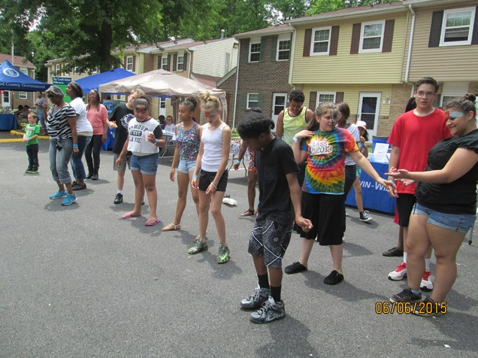 Attendees at the 2015 Summer Jam take part in a line dance.