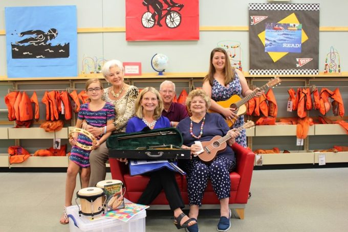 Mary Hastler, CEO of Harford County Public Library (front center), is joined by Tina Doyle, president of The Morris A. & Clarisse B. Mechanic Foundation (front right) at the launch of the LEAP Music collection. Joining them are Caelen Doyle and her grandmother, Carolyn Lambdin, secretary of the Mechanic Foundation and vice president of the Harford County Public Library Foundation; Joe Lambdin; and Nina Depkin, foundation specialist with Harford County Public Library. (Photo Courtesy of Harford County Public Library)
