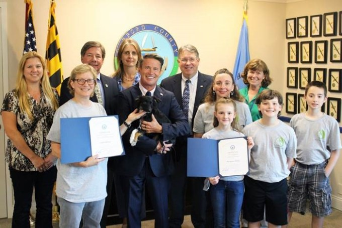 Pictured from left, front row: Linda Andrews; County Executive Barry Glassman with Linda's dog, Toby; Dr. Danielle Orlando-Kepner and her children Gianna, Kiegan, and Tristen Back row from left: Harford County government officials Laura Coste, Watershed Protection and Restoration Office; Joseph J. Siemek, director of Public Works; Christine Buckley, Watershed Protection and Restoration Office; Scott Kearby, deputy director of Public Works, and Kriste Garman, Parks & Rec