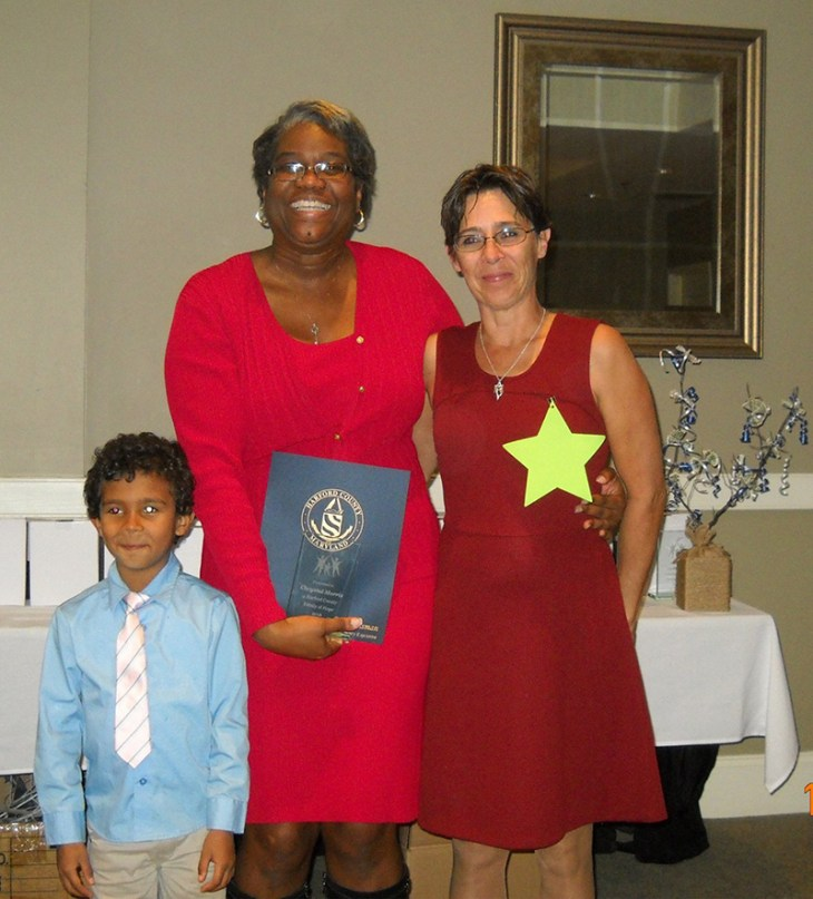 Nicki Biggs, Executive Director of The SUCCESS Project (left) presents Chrystal Morris (right) and her son with their award as top fundraisers for The SUCCESS Project Families of Hope Campaign. The award was presented  during the November 4 Gala of Hope held at Bulle Rock. The Gala was the grand finale of the Families of Hope Campaign, Harford County's first inter-agency public awareness and fundraising collaborative.