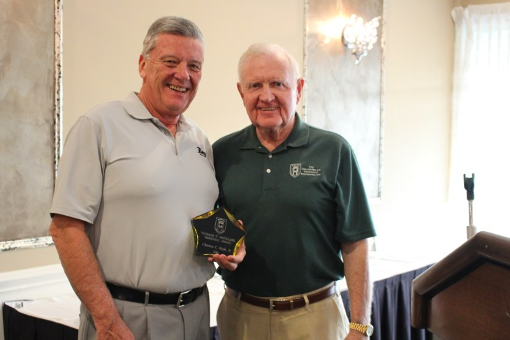Bill Cox, president of The Greater Bel Air Community Foundation (right), presents the first Thomas P. Broumel Memorial Award to Chuck Boyle, dealer and president of Boyle Buick GMC, at the foundation's 15th Annual Golf Classic October 17 at Maryland Golf and Country Club. (Photo Courtesy of Mary Hastler)